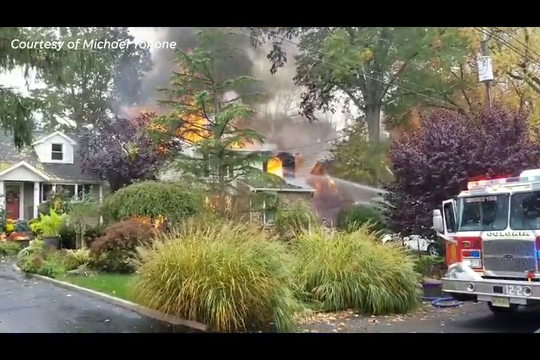 Video taken by Michael Yonone showed a Woodbridge Township home in flames and a neighboring home beginning to catch fire, too.
