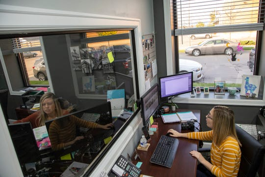 Closing coordinator Katie Keasey, left, and listing coordinator Amber Belcher of Century 21 Curran & Oberski work at their desks Thursday, Oct. 24, 2019 at their Dearborn Heights offices. Century 21 Curran & Oberski are finalists for the Detroit Free Press Top 10 Work Places.