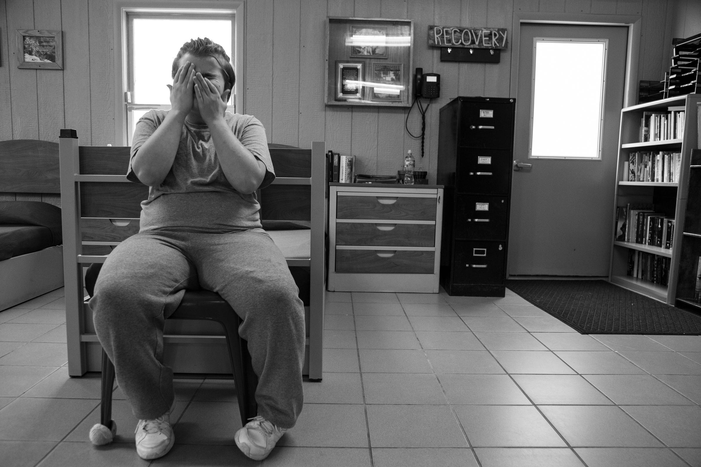 The Girl From Taylor sits in a chair by her bed Thursday, July 25, 2019, she along with other clients were court ordered to Wolverine Growth and Recovery Services in Vassar, a program designed to intervene with alcohol, drug and behavioral issues.