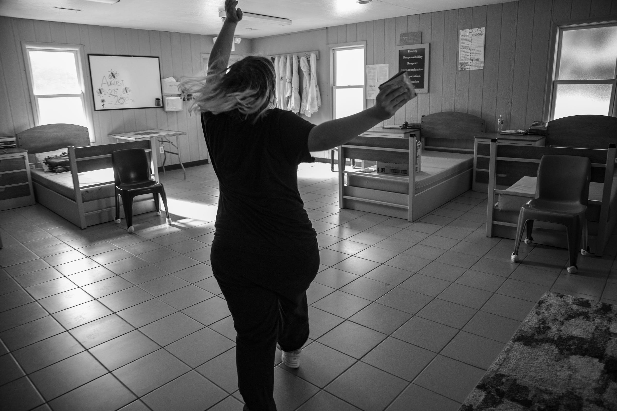 """The girl from Taylor, dances with joy through her residents hall at the Wolverine Growth and Recovery Center, before she leaves the program Monday, Aug. 28, 2019. """"I am really excited"""" I really want to go to prom"""" she said of getting out."""