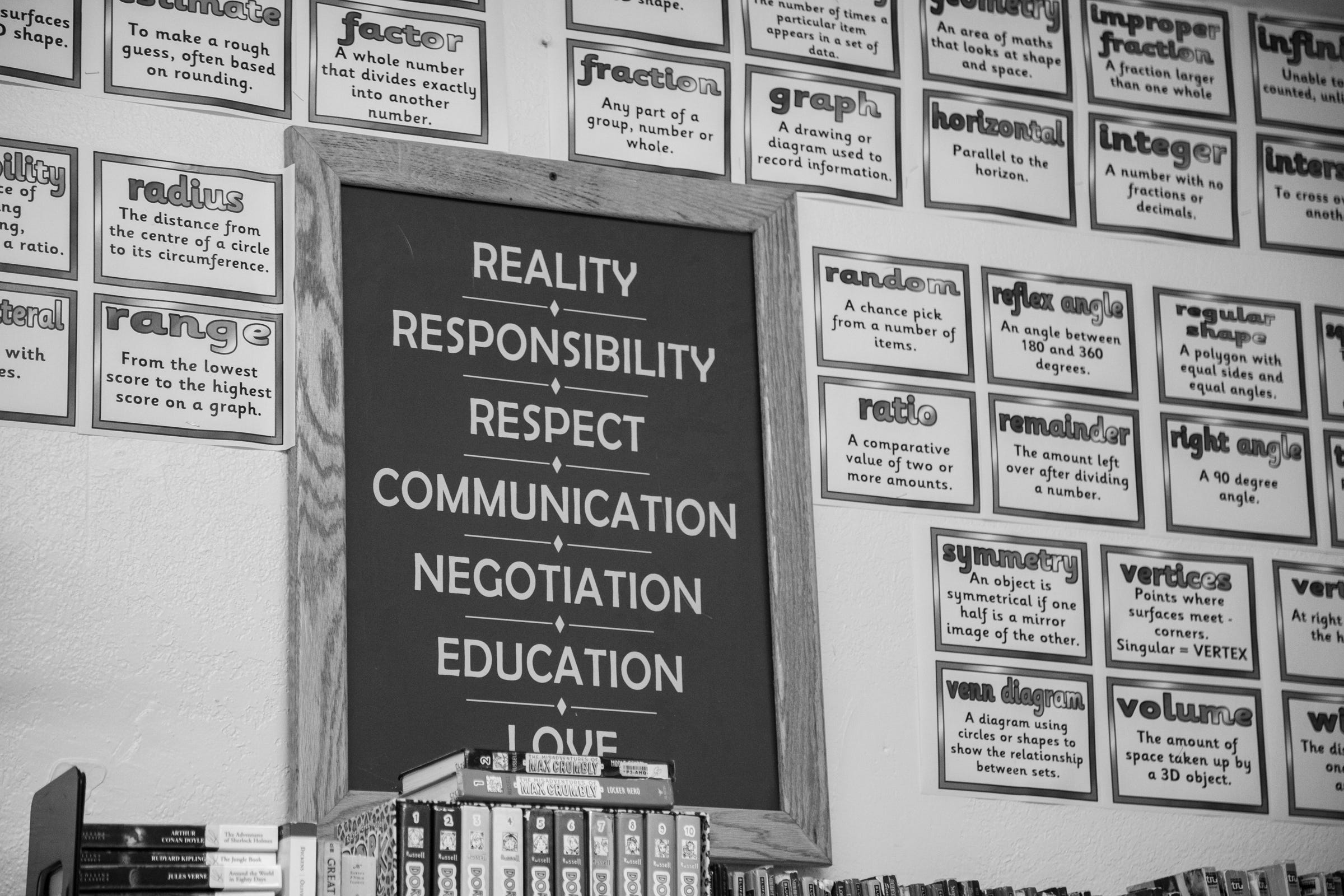 Signs coaching life skills on the classroom wall at Wolverine Growth and Recovery Center in Vassar, July 25, 2019.