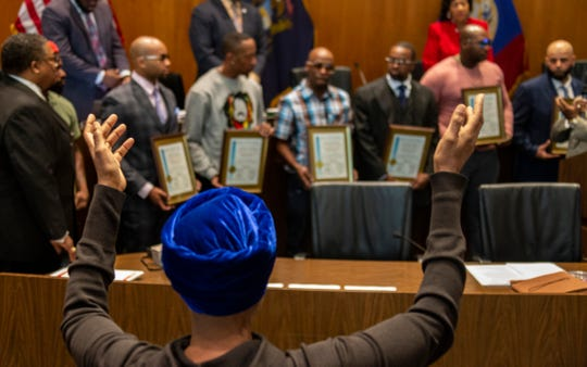 City Council meets Tuesday, Oct. 29, 2019 in the Erma L. Henderson Auditorium to honor men who were wrongfully convicted including James Clay. A woman holds her hands up in prayer for all the recipients being honored for wrongful convictions.