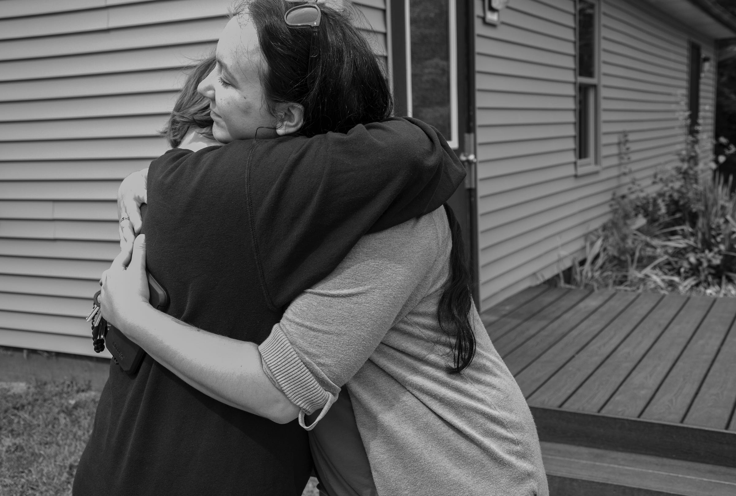 The girl from Taylor, left, hugs her therapist Rebecca Lutz at Wolverine Growth and Recovery Center in Vassar Monday, Aug. 26, 2019. The girl was court ordered to this facility which is part juvenile detention center and part residential drug rehabilitation.