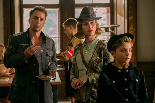 "Sam Rockwell, left, Scarlett Johansson and Roman Griffin Davis in ""Jojo Rabbit."""
