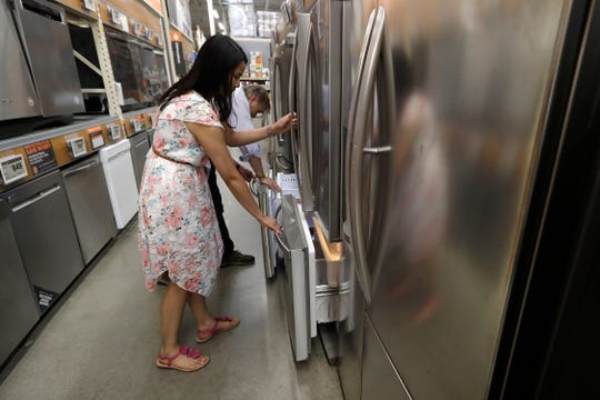 Shoppers examine refrigerators at a Home Depot in Boston.