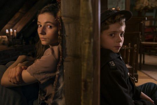 "Thomasin McKenzie and Roman Griffin Davis in ""Jojo Rabbit."""