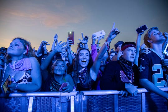 Fans attend the Voodoo Music Experience on Sunday in New Orleans. Major concert promoters in the U.S. are stepping back from plans to scan festival-goers with facial recognition technology, at least for the time being.