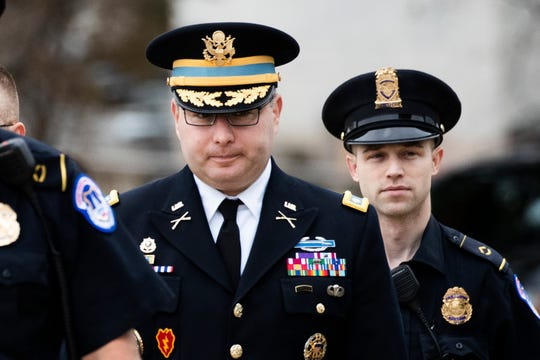 Army Lt. Col. Alexander Vindman, a military officer at the National Security Council, center, arrives on Capitol Hill in Washington, Tuesday, Oct. 29, 2019, to appear before a House Committee on Foreign Affairs, Permanent Select Committee on Intelligence, and Committee on Oversight and Reform joint interview with the transcript to be part of the impeachment inquiry.