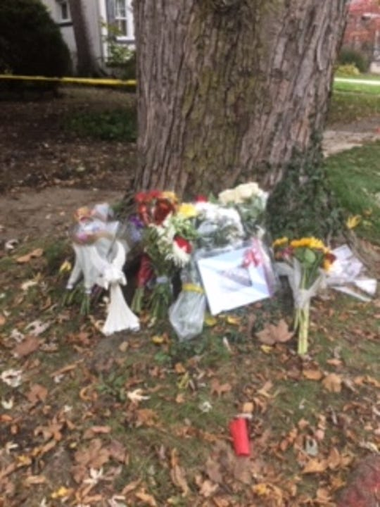 Well-wishers are leaving flowers outside the Connolly family's Grosse Pointe home, where brothers Walter Briggs, 11, and Logan, 9, died in a fire Monday.