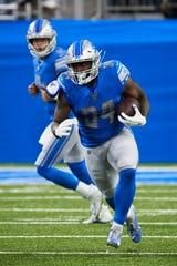 Tra Carson (34) got the start at running back and saw the most touches at the position in the Lions' win over the Giants.