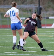 Elmira's Ireland Krawczyk (18) knocks the ball away from Horseheads' Miran Novitsky (10) during the Express' 2-0 win in a Section 4 Class AA girls soccer semifinal Oct. 29, 2019 at Ernie Davis Academy.