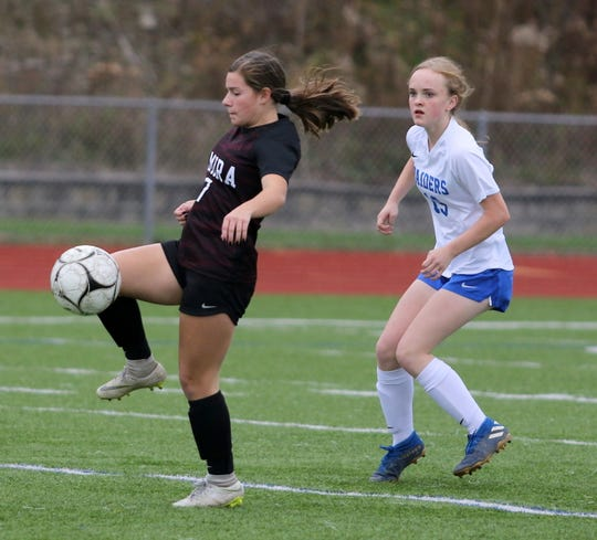 Tierney Krawczyk of Elmira tries to control the ball in front Aela Shaw of Horseheads during the Express' 2-0  win in a Section 4 Class AA girls soccer semifinal Oct. 29, 2019 at Ernie Davis Academy.