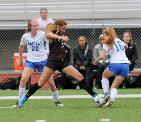 Parker Moss of Elmira tries to control the ball in between Horseheads' Rachel Williams (20) and Olivia Laney (16) during the Express' 2-0 win in a Section 4 Class AA girls soccer semifinal Oct. 29, 2019 at Ernie Davis Academy.