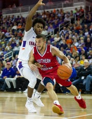 USI's Braden Fitzjerrells (4) moves past UE's Shamar Givance (5) during the USI-UE exhibition game at the Ford Center in Evansville, Monday, Oct. 28, 2019.