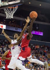UE's Deandre Williams (13) tries, unsuccessfully, to block USI's Darnell Butler (24) at the USI-UE exhibition game at the Ford Center in Evansville, Monday, Oct. 28, 2019.