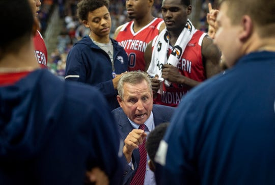 USI coach Rodney Watson talks to his team during a timeout at the USI-UE exhibition game at the Ford Center in Evansville, Monday, Oct. 28, 2019.