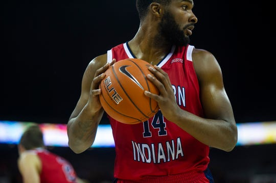 "USI's Emmanuel Little (14) at the USI-UE exhibition game at the Ford Center in Evansville, Monday, Oct. 28, 2019. Little, who was recruited by Watson, felt ""blessed"" to be able to contribute in his head coach's record-breaking victory."