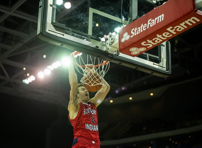USI junior Clayton Hughes dunks during the USI-UE exhibition game at the Ford Center in Evansville, Monday, Oct. 28, 2019.