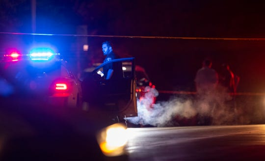 Evansville Police Department personnel conduct an investigation of a police-involved fatal shooting on Morgan Avenue just west of Theater Drive Monday night.