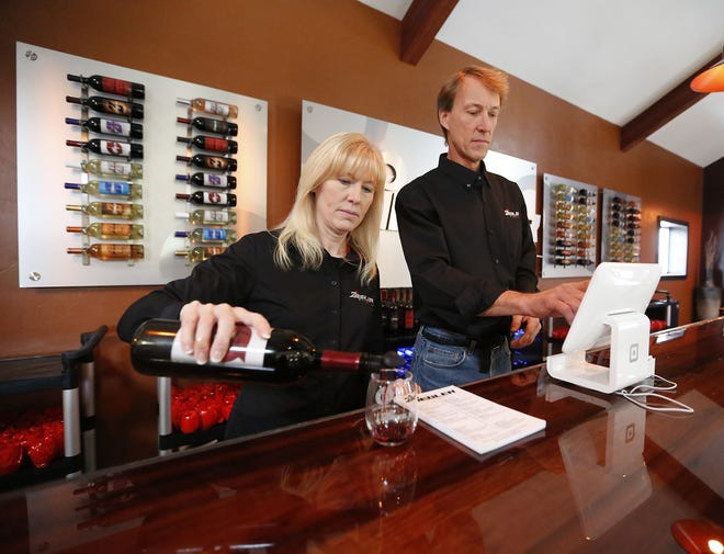 Jenny and Randy Ziegler get ready for business in the tasting room at Ziegler Winery, in Malone, Wisconsin. The business opened three weeks ago along the east shore of Lake Winnebago, Saturday, October 26, 2019. Doug Raflik/USA TODAY NETWORK-Wisconsin