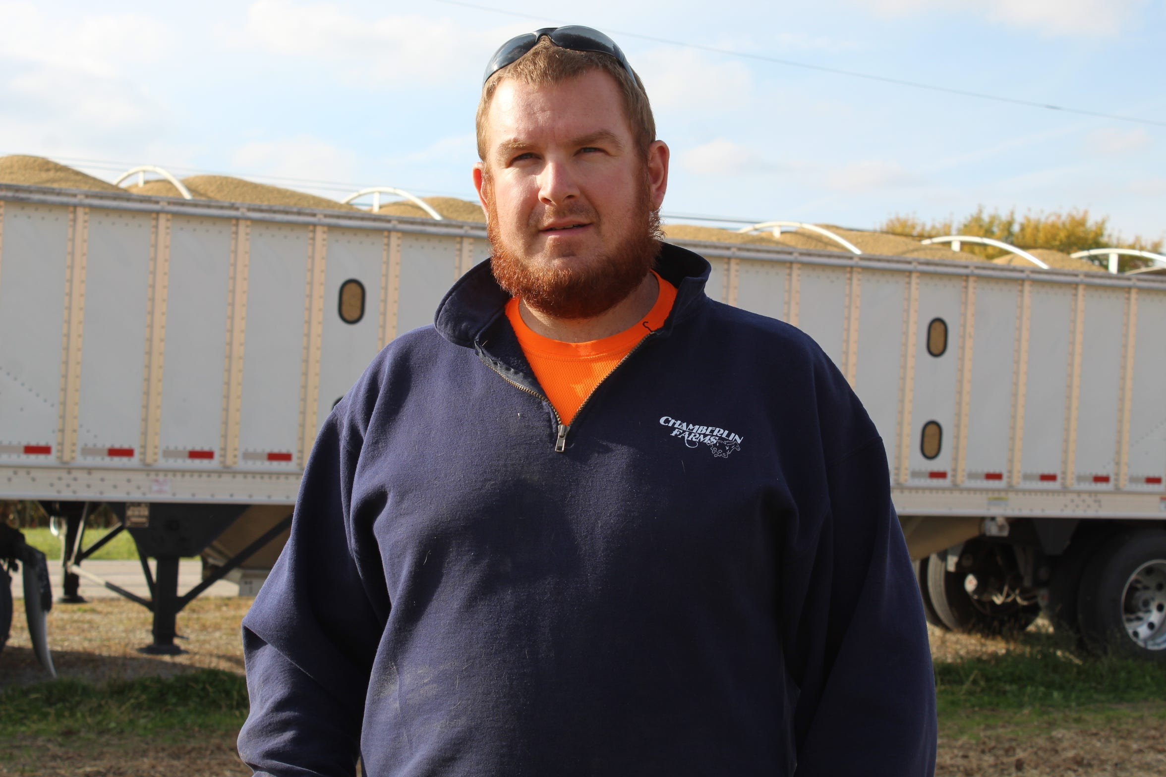 Genoa farmer Chad Gargas stands in front of a truck filled with harvested soybeans Oct. 24, as he prepares to haul a load to The Andersons in Toledo.