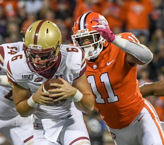 Clemson safety Isaiah Simmons (11) pressures Boston College quarterback Dennis Grosel during the second quarter at Memorial Stadium with Boston College in Clemson, South Carolina Saturday, October 26, 2019.