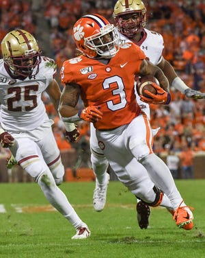 Clemson wide receiver Amari Rodgers (3) runs by Boston College defensive back Mehdi El Attrach for a touchdown  during the second quarter at Memorial Stadium with Boston College in Clemson, South Carolina Saturday, October 26, 2019.