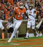 Clemson wide receiver Diondre Overton (14) runs by a Boston College player to the end zone during the first quarter at Memorial Stadium before the game with Boston College in Clemson, South Carolina Saturday, October 26, 2019.
