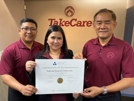 Arvin Lojo, TakeCare health plan administrator, Rose Grino, RN, FHP Health Center health delivery administrator, and Lucio Almira, TakeCare comptroller and corporate administrator, prepare to display the certificate of national accreditation from the Accreditation Association for Ambulatory Health Care at the TakeCare office in Tamuning. TakeCare recently received notice of its renewal to the AAAHC after complying with its audit and program