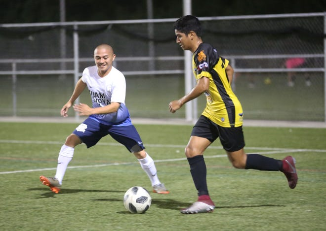 NAPA Rovers FC's Devan Mendiola looks for an opportunity to move toward the goal with the ball against Guam Shipyard during a Week 2 match of the Budweiser Soccer League Premier Division Saturday at the Guam Football Association National Training Center. The Rovers won 10-0.