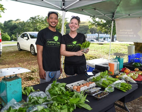 Farm to Table Guam Corp. Farm Manager Roland Santos and Project Director Cassie Brady at their produce stand in Hagåtña, Oct. 29, 2019.