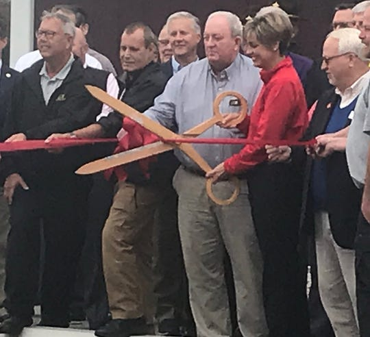 Jailer Amy Brady stands with Ron Spencer (project leader) and cuts the ribbon on a new office for Probation and Parole (Oct. 29, 2019).