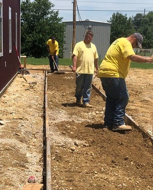 Inmates with the Henderson County Detention Center work to construct a new building. The building is being leased by Probation and Parole for its new Henderson office.