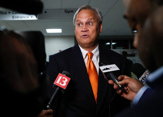 State Senator Jim Merritt addresses media after the final mayoral debate at MSD Wayne Township Chapel Hill 7th & 8th Grade Center, Monday, Oct. 28, 2019, Indianapolis.