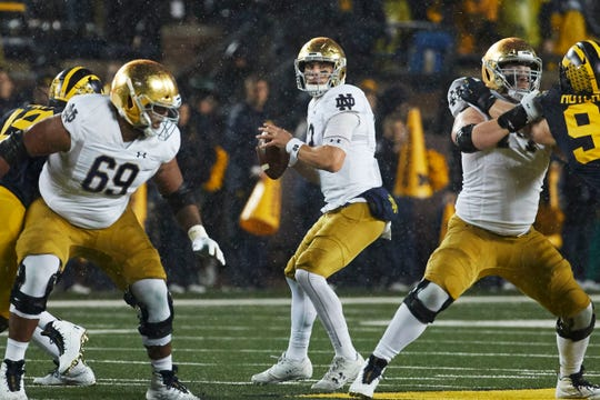 Ian Book struggled mightily in the rain against an aggressive Michigan defense.