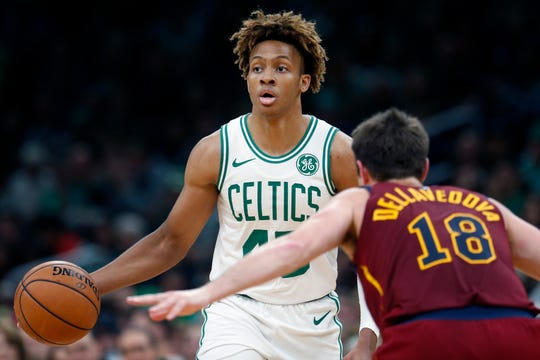 Boston Celtics' Romeo Langford (45) plays against Cleveland Cavaliers' Matthew Dellavedova (18) during the second half of an NBA preseason basketball game in Boston, Sunday, Oct. 13, 2019.