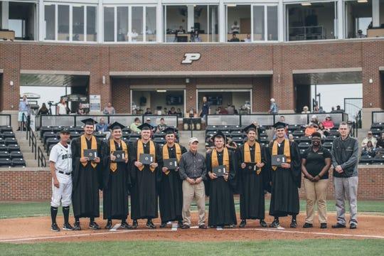 Mitch Daniels (center) with the 2018 Purdue baseball team graduates.