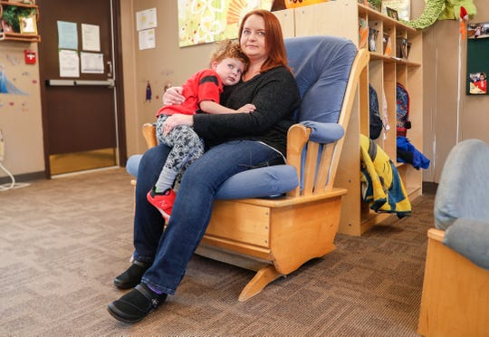 Jeannie Bellmar holds her son Liam who attends Concord's Nationally Accredited Childcare at Concord Neighborhood Center, Thursday, Oct. 24, 2019, Indianapolis.
