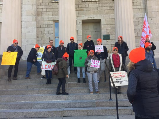 In pursuit of more sick leave benefits, non tenure-track faculty stand on the steps of the Old Capital, trying to get the attention of Faculty Senate members.