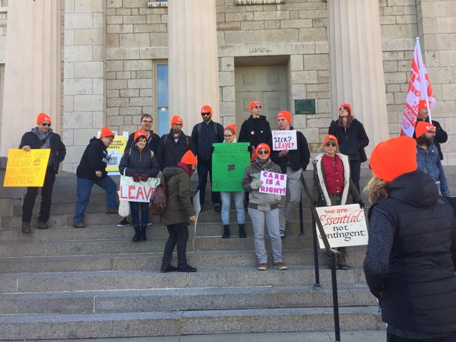 In pursuit of more sick leave benefits, non tenure-track faculty stand on the steps of the Old Capital on Oct. 29, trying to get the attention of Faculty Senate members.