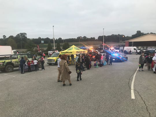 Children got candy from different booths set up by businesses and emergency personnel at The Ballpark at Jackson on Monday.