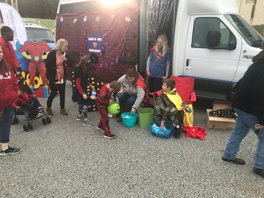"""First United Methodist Church in Downtown Jackson had a candy stop set up with """"Jesus is our Super Hero"""" as its theme."""