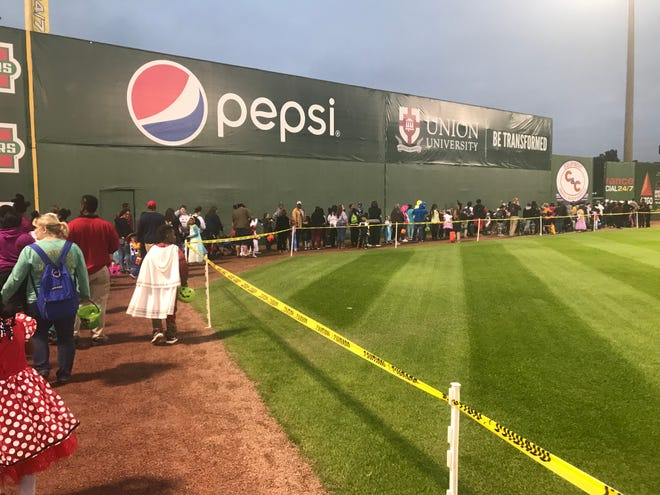 Walking up the third base line and on the warning track in left field of the baseball field was the last stop before getting candy on the other side of the wall.