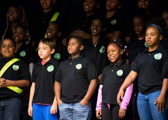 The Green Magnet STEAM Academy chorus sings a song during the school's 110th anniversary celebration on Friday, Oct. 25, 2019.