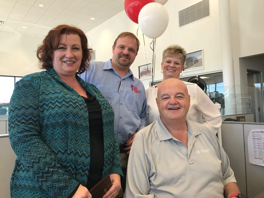 Matt Taylor Kia salesman Doug Mosack (front) sits with employees who helped save his life on Aug. 5 when he suffered a heart attack during a sales meeting. Standing from left are Heather Parks, Brian Metzler and Keila Kline.