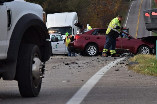 Crews work to clean up the scene of a two-car crash on US 22 Tuesday morning. The Ohio Highway Patrol confirmed both drivers were killed in the crash.