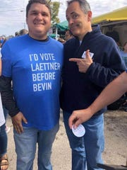 "Gov. Matt Bevin posed for a photo with Thomas Conlee, wearing a ""I'd Vote Laettner Before Bevin"" shirt, in mid-October at the Mt. Sterling Court Days Festival."