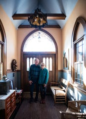 Jacqueline Drewes and brother Brian Doyle in the entryway of her home in Eaton Rapids, which they've been working on for over 11 years.