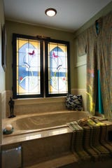 A bathroom in Jacqueline Drewe's Eaton Rapids home that once was a church.