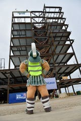 Sparty joined the celebration and helped give the signal to raise the final beam.